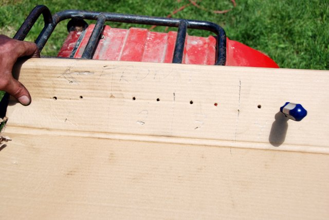 A cardboard holder is made to keep the removed pushrods in proper sequence for re-installation